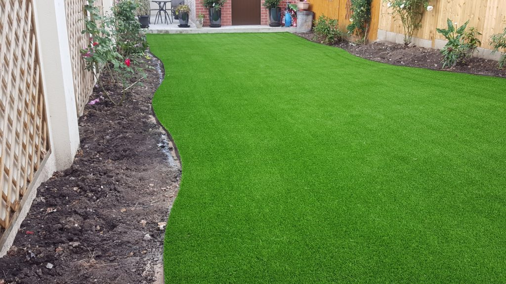 Final step, installation of artificial grass at Mrs Marinello, Sevenoak