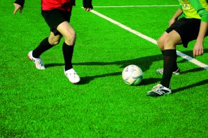 Playing football on an Artificial Sports Pitch or Astroturf