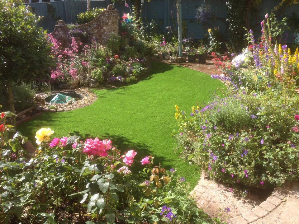 artificial grass installation with country flowers