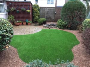 shaped synthetic lawn installation