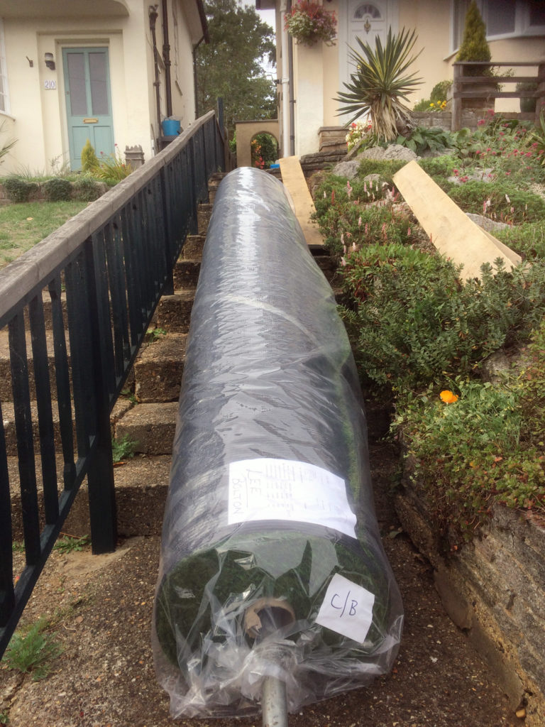 Taking 160m2 of artificial lawn up a small garden path