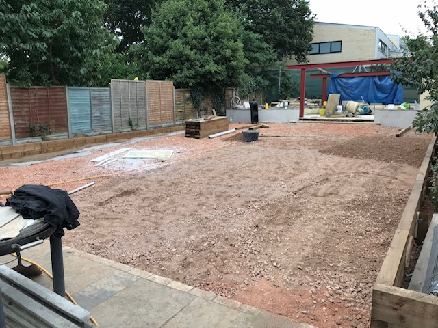 "The site is filled and levelled with ""road stone""."