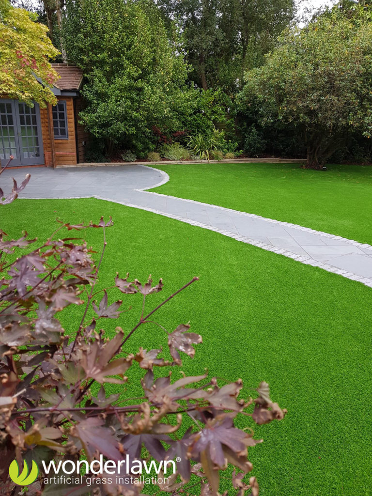 an artificial grass installation in Surrey with path