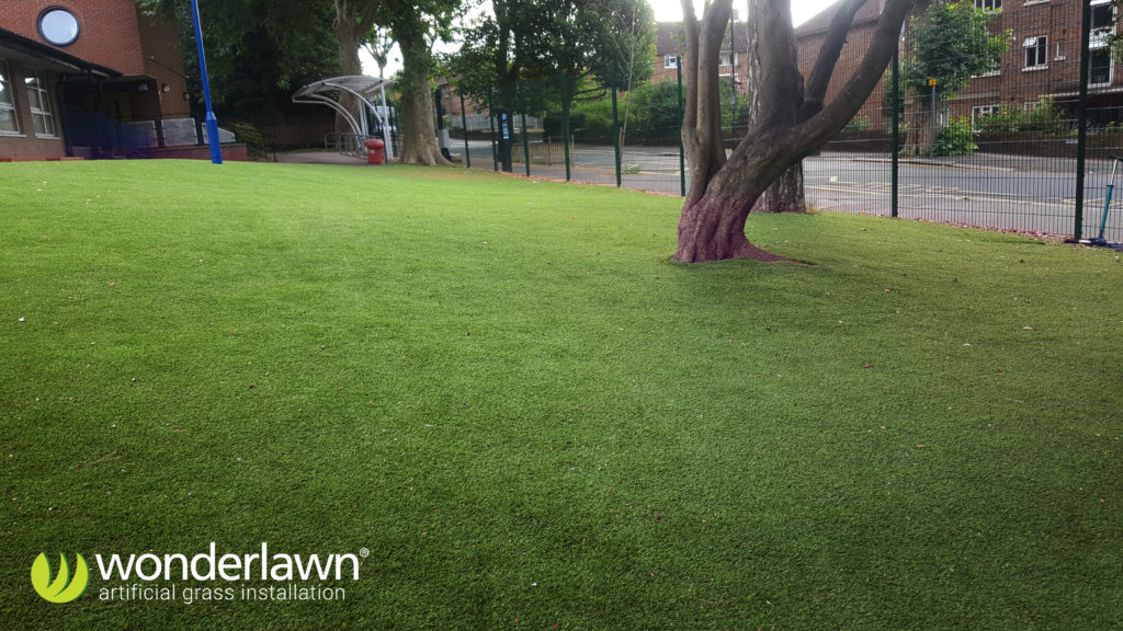 the students of biship gilpin school have a safe clean artificial grass lawn to play on