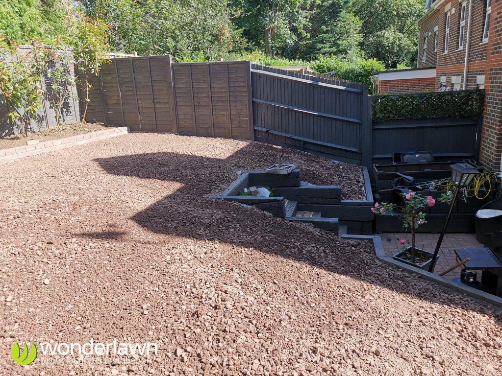 a sloped artificial grass installation