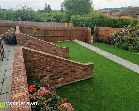 A beautiful tiered artificial grass installation Hampshire