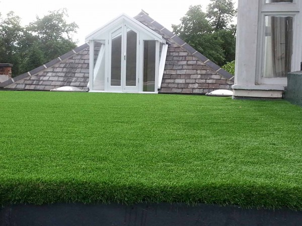 artificial grass installation on a flat roof